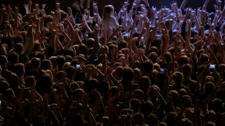 rock concert : Applause. A crowd of people at a rock concert. Fans gather in front of the performance of a rock band.