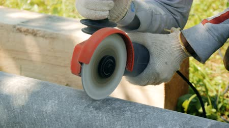 azbest : Worker, cuts the pipe from asbestos Wideo