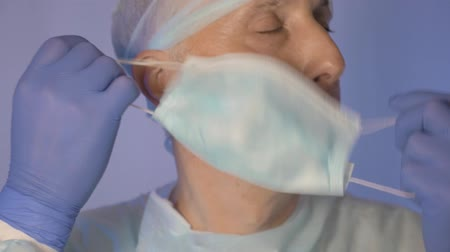 antimicrobial : The surgeon, who is very tired, takes off the medical mask. Stock Footage