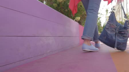 тапки : Close-up, female legs in blue slippers, which moves away from the camera, from the focus zone to the area outside the focus