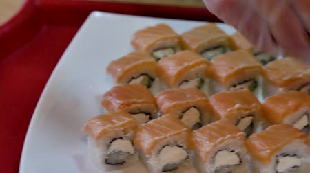 sake : Fresh sushi spread on a plate. Stock Footage