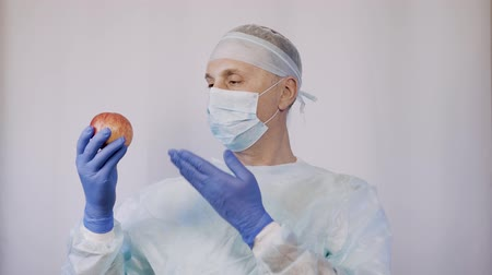 antimicrobial : The attending physician shows the patient an apple. These are the best natural vitamins for health. Stock Footage