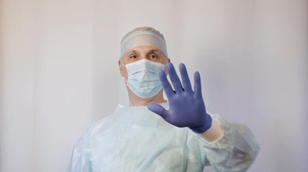 antimicrobial : A surgeon in a medical mask shows a hand gesture - stop. Must stop. Stock Footage