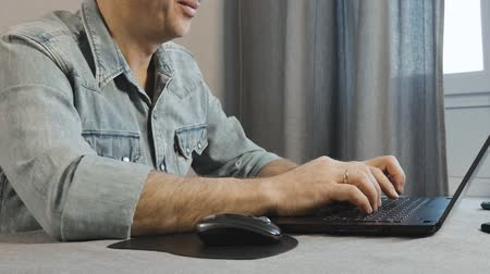 vstup : Male hands are typing on the keyboard of the laptop. Close-up. Freelancer work at home.