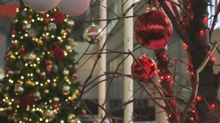 christmas ball gold : Christmas balls close-up. toys hanging on the tree. The city is decorated for the holiday. Colored garland