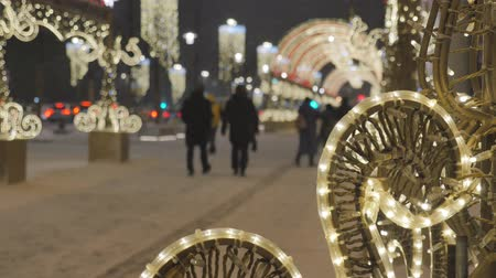 Christmas decoration close-up. In the background, cars are out of focus and people are walking. Festive atmosphere. Wideo