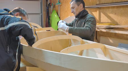 inventor : Two men independently make a boat of wood. They themselves invented the design of the vessel for their travels.