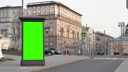 day City street Showcase with green screen stands against backdrop of buildings Wideo