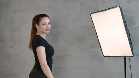 Caucasian girl with a long tail posing in front of the camera