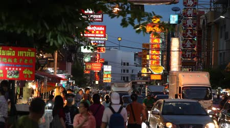 streetlights : BANGKOK, THAILAND -  Dec 15 2018: Cars and shops on Yaowarat road. Chinatown with notable Chinese buildings, restaurants and decoration. Busy Yaowarat Road in the evening Bangkok, Thailand