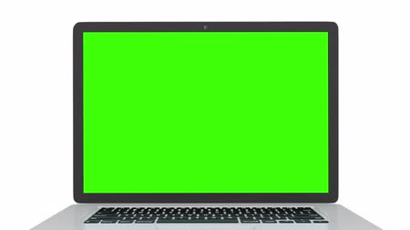 notebooklar : Isolated laptop with green screen on white background. Camera rotating around notebook. Template empty green screen. Stok Video