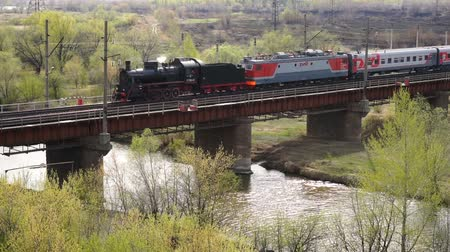 ural : MAGNITOGORSK, RUSSIA - May 04 2017: Vintage steam train moving on bridge