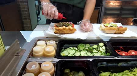 prepare food : Food court. Sandwiches preparation in local fast food location. Stock Footage
