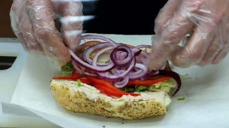 sandviç : Sandwich praparation. Adding sweet onion and paper footage Stok Video