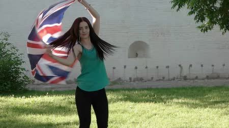 zvedák : woman dancing with union jack outdoors slowmo footage Dostupné videozáznamy