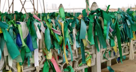 astrakhan : Traditional green ribbons on the fence of muslim tomb on wind in Astrakhan Russia Stock Footage