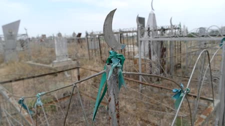 astrakhan : Green ribbon on the fence of old historic tombstone in the muslim cemetery Astrakhan Russia