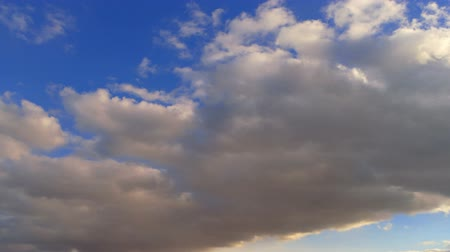 coulds : White clouds running over deep blue sky Stock Footage
