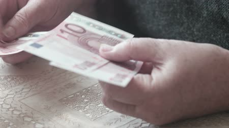 indigence : Old woman counting euro banknotes Stock Footage