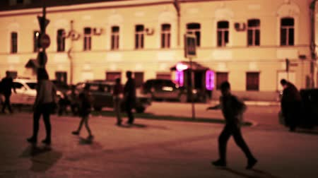 honit : Man chase a boy. Urban night scene, Defocused. Toned shot