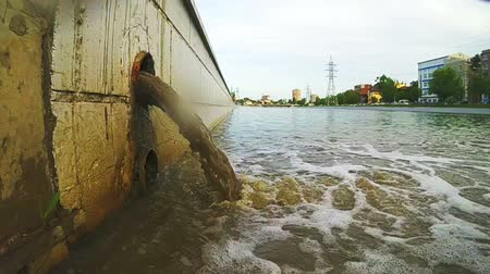discharging : Sewage Pipe Discharging Into The River. The drain carries sewage
