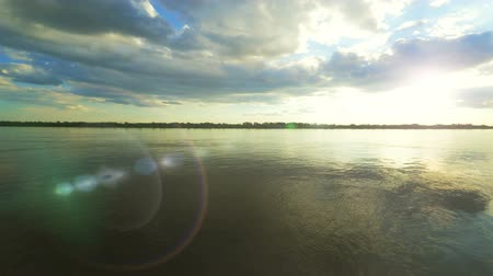 astrakhan : Timelapse summer Volga River and forest on far riverbank. Astrakhan, Russia