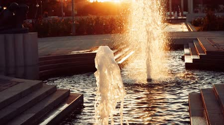 strokkur : Slow motion of Fountain in the city park in sunset time backlit