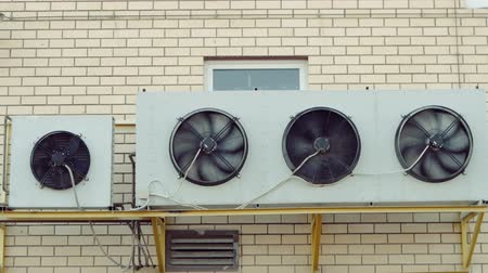 refrigerant : A wall mounted industrial heating and cooling system of mall building.