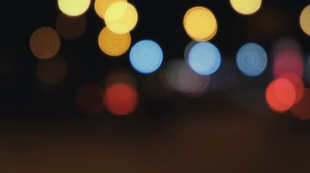 xenon lights : Гкифт Екфаашс Defocused night lights abstract defocused background Stock Footage