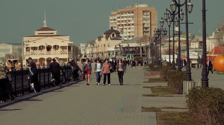 astrakhan : Astrakhan, Russia - 24 of April 2018: Pedestrians walking along Volga-river embankment in sunny day