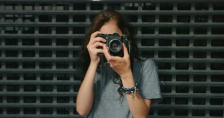 ha : Hipster Girl Taking Photo By Vintage Film Camera In Front Of Metal Grid Fence