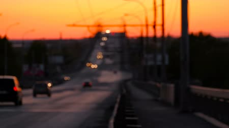 akşam : look over the bridge with defocused cars on, sunset Stok Video