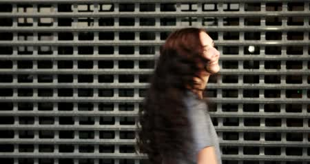 perimeter : Closeup of teen girl look back and applause in front of metal grid fence Stock Footage