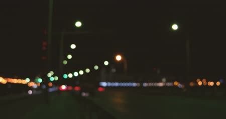 xenon lights : Abstract blurred colorful circles of cars on overpass (defocused night freeway scene), hyperlapse 4k footage Stock Footage