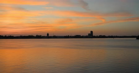 astrakhan : Summer sunset cityscape panorama 4k time lapse. Timelapse of sunset over Volga-river, Russia Stock Footage