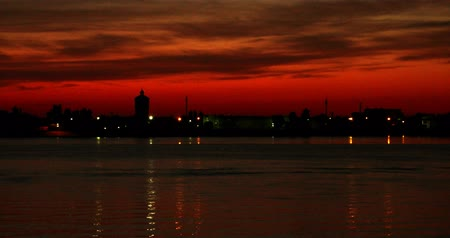 astrakhan : Sunset over Volga-river In Astrakhan with beautiful red sky, timelapse DCI4K. Summer sunset cityscape panorama 4k time lapse.