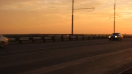 akşam vakti : Cars on morning freeway moving in slow motion pan right shot FHD footage
