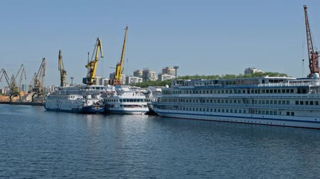 moorage : Moscow, Russia 15 of May 2015: Moored Cruise Vessels In Front of Port Cranes of North River Port In Moscow Russia