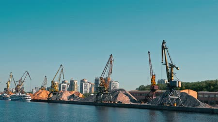 moorage : Moscow, Russia 15 of May 2015: Port Cranes And Bulk Of Sand In Old River Port Of Moscow View From moving Boat