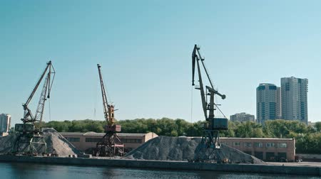 moorage : Moscow, Russia 15 of May 2015: Used Port Cranes And Balks Of Sand On Pier In Old Riverport On Moscow-river, North Of Moscow Russia. View From Passing Boat. Stock Footage