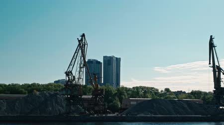 mooring : Moscow, Russia 15 of May 2015: Moscow-river boat trip view at at Old River Port with working cranes. Stock Footage