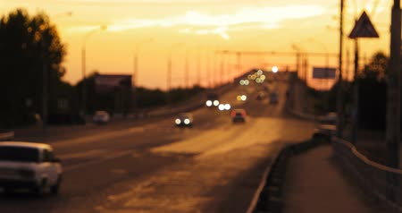 night scape : Traffic of commuters cars in sunset time on overpass. Yellow sunset sky as background 4k footage Stock Footage