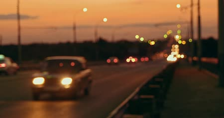 congestionamento : Commuters traffic on the night road in front of sunset sky with headlights Stock Footage