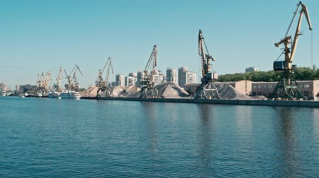 moorage : Defocused port Cranes Of Old Northern River Port On Moscow-river View From Cruise Boat Stock Footage