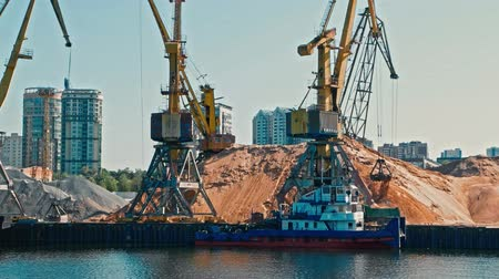 moorage : port Cranes Working in Riverport Loading Tracks With Sand View From Moving Boat