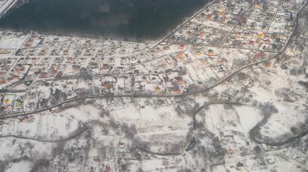 sąsiadka : Moscow Region Suburban residential neighborhood houses district covered with snow aerial view in 4k