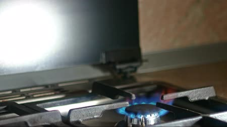 concoction : Stove gas burner working, small flames of blue fire, copyspace