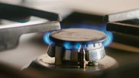 gas hob : Close-up shot of the blue flames of the burner of a gas stove 4k footage Stock Footage
