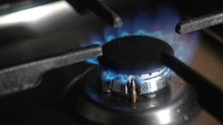 gas hob : Kitchen gas stove with burning blue natural gas 4k footage