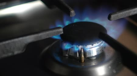 gas burner flame : Kitchen stove burner turning on close up on the flame, copyspace 4k footage